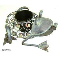 Metal frog figurine with candleholder