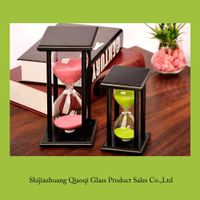 Wooden frame glass hourglass