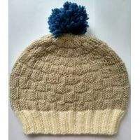 hand knit beanie with pom pom in contrast colors