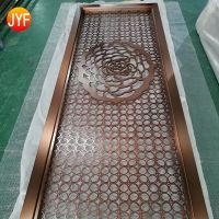 Metal screens with brass color used as the decorative background wall