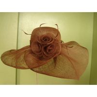 Sinamay big brim hat with rosette and netting