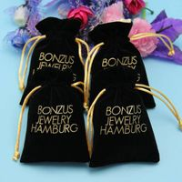 black color drawstring velvet jewelry pouch with gold logo printed thumbnail image