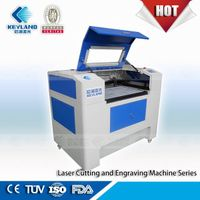 Leather engraver of Puma shoes laser engraving machine price with Red light pointer