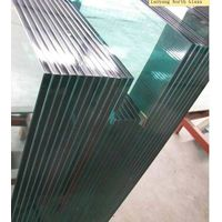 Tempered laminated building glass