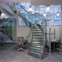 Interior curved stairs with glass tread