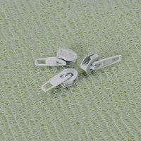 Zipper sliders, non-lock, auto, semi, semi auto, pin, etc..