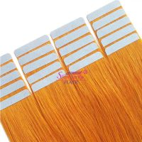 Tape in hair extensions orange