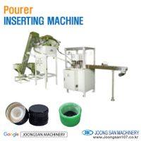 Pourer cap inserting machine