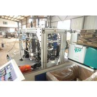 Paper lid forming machine