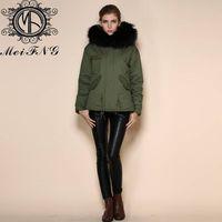 Women's faux fur jacket with raccoon trim hood