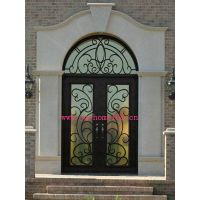 Wrought iron arched double entry door