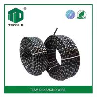 Diamond wire saw for cutting reinforced concrete and quarry stones