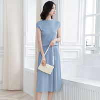 Women Knit Two-pieces suits including Sleeveless Crewneck Knit Tees and Pleated midi Skirts thumbnail image