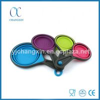 4 Piece Folding Collapsible Silicone Measuring Cup Set with Plastic Handle thumbnail image