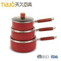 Aluminum non-stick red coating saucepan with full induction bottom and soft touch handle