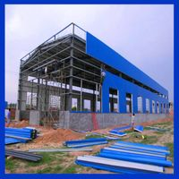 Steel framed building with attached small house