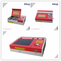 Mni and Desktop Laser Cutting Acrylic/Organic Glass/Stamp Making Machine RJ4040