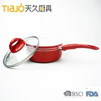 Aluminum ceramic red saucepan with white ceramic coating and glass lid