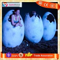 Take amusement photo with hatching dinosaur egg model