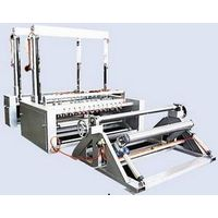 Gauze slitting cutting and rewinding machine thumbnail image