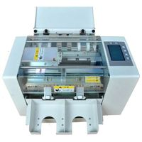 AUTOMATIC PAPER CUTING MACHINE