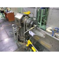 Continuous lead sheathing extruder