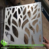CNC laser cutting metal panel with tree pattern