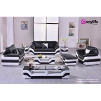 Modern black leather sofa set with tables and ottoman