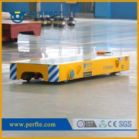 Rail powered transfer trolley for heavy duty material handling