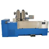 Double head grinding machine for rotogravure cylinder