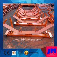 erosion resisting self-aligning conveyor roller frame for belt system