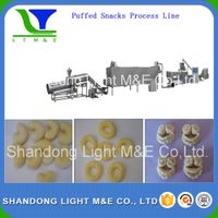 Double-screw extruder inflating snacks food processing line