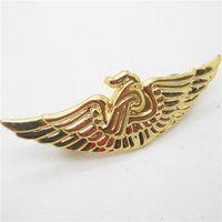Metal wings badge