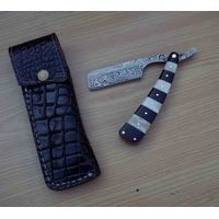 Damascus razor with leather cover