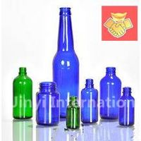 Different Sizes of Glass Blue Bottles