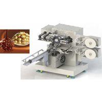 Automatic tresor dore wrapping machine (Ferrero)