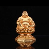 The golden happy buddha stuatue is seated in a double lotus base show his smiling and big belly thumbnail image