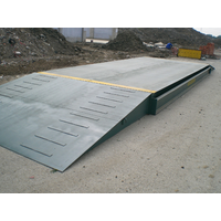 Pitless installation truck scale with steel ramps