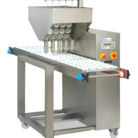 Automatic cup-cakes filling machine