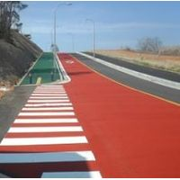 Non-skid coating material for roads