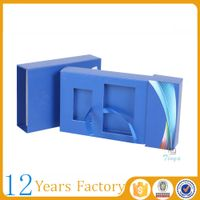 small electronic packaging blue cardboard boxes