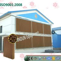 Evaporative cooling pad for layer houses