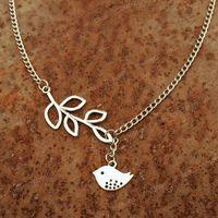 Handmade bird charm necklaces and bracelets