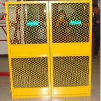 Construction elevator wellhead protective door