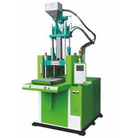 Single slide table vertical injection machine