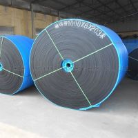 Layered conveyor belt with flame retardant covering rubber