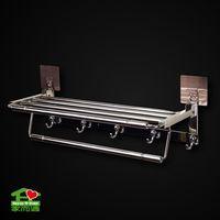Adhesive foldable storage shelf