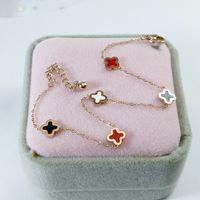 Four Leaf Clover 18K gold tennis charm bracelet