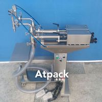 Semi-automatic two nozzles liquid filling machine