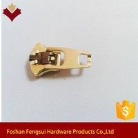 Key locked golden brass zip slider for jean